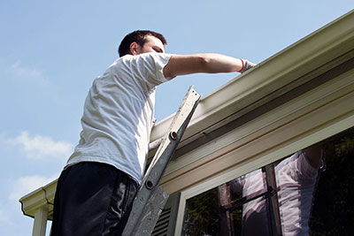 alcoil professional changing gutters roofing